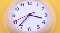 istock Clock on the yellow wall in the foreground 1263164483