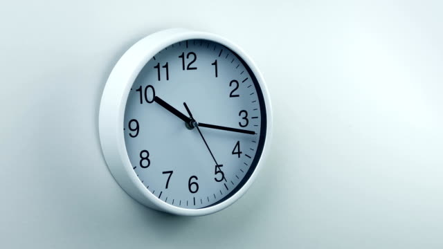 clock on wall generic home or office area - office cubicle stock videos & royalty-free footage
