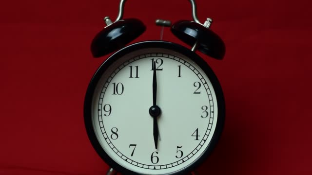 Clock ringing to 6 o'clock on the red background