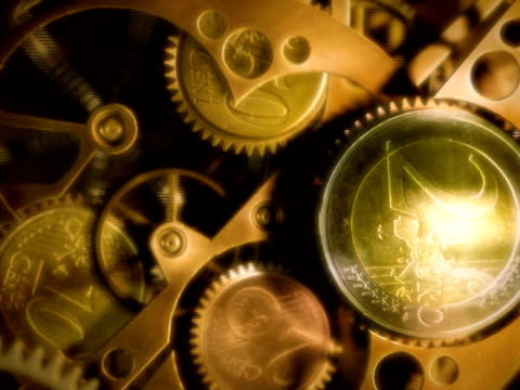 Clock with coins in place of gears. Time is money. video