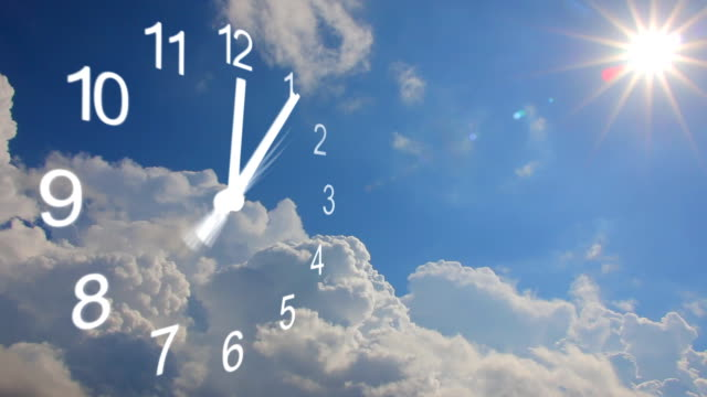 Clock with rolling cumulus clouds, time lapse video