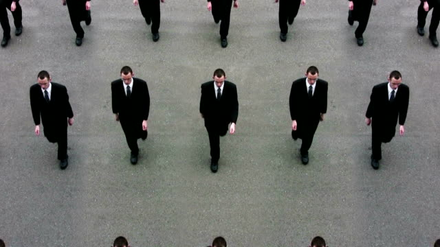 cloned businessmen, ready for world domination - ripetizione video stock e b–roll