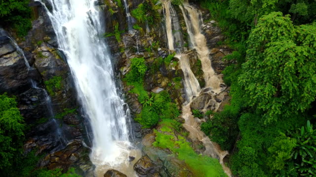 Close approach to waterfall aerial view from drone in rain forest, Wachirathan waterfall in Chiangmai, Thailand. video