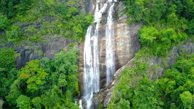 Close approach to waterfall aerial view from drone in rain forest, Siriphum waterfall in Chiangmai, Thailand. video