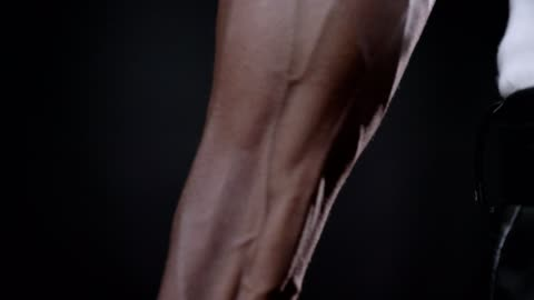 Close footage of african man's vascular strong hand, beautiful muscular body, isolated on black background Close footage of african man's vascular strong hand, beautiful muscular body, isolated on black background. arm stock videos & royalty-free footage