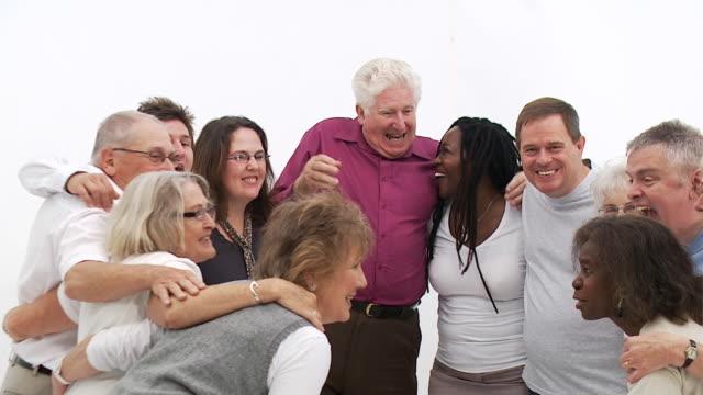 close group of mixed age and senior people - mature women studio grey hair bildbanksvideor och videomaterial från bakom kulisserna