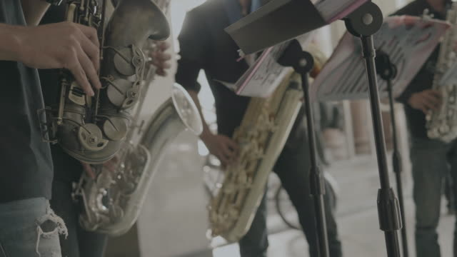 Close of of Musician are playing Jazz band performing at the road video