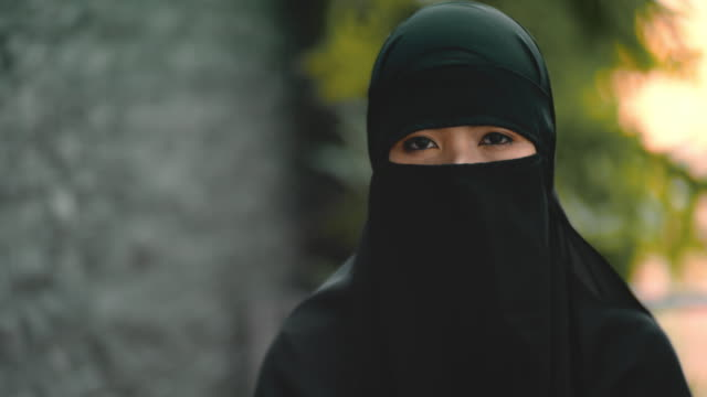 Close portrait of young muslim woman in hijab