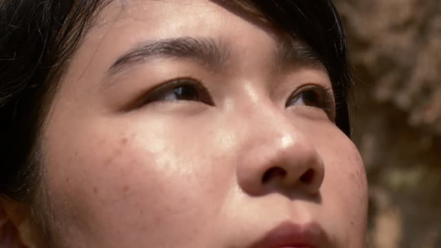 close uo face asian young lady looking for hope video