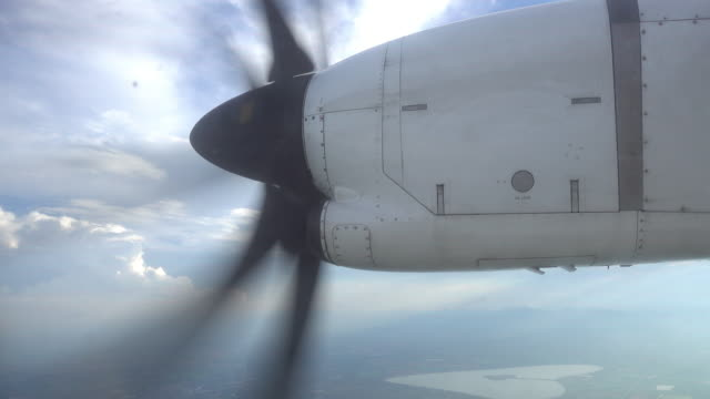 Close up airplane blade when flying in sky over city
