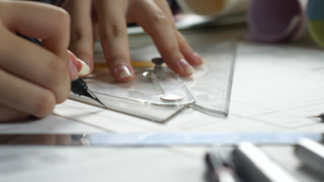 Close up Architect working with laptop and blueprint on Drawing table video