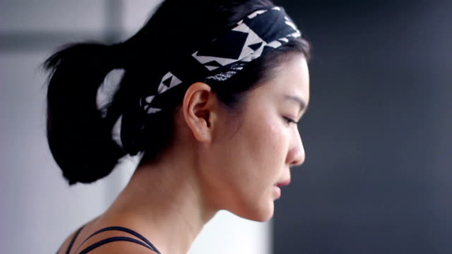 close up asian girl sweating face running at fitness video