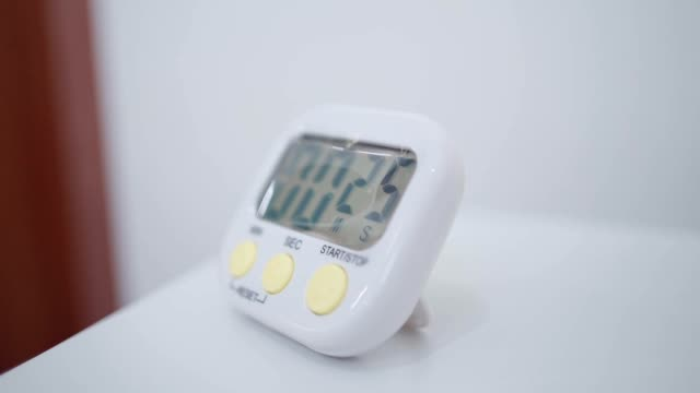 Close up asian hand press down stop watch button to begin count down for 30 seconds, time out over time, ticking hour, appointment deadline, digital stop watch scale, counting down minutes, stop clock