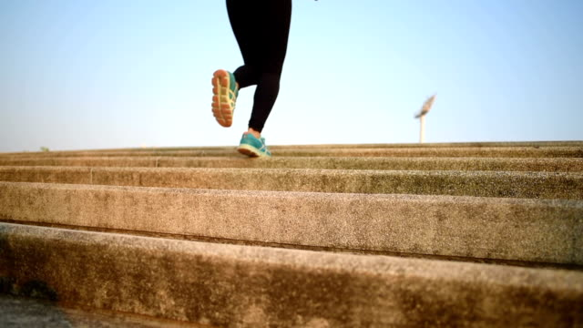 close up asian young fitness woman running on stairs - staircases stock videos & royalty-free footage