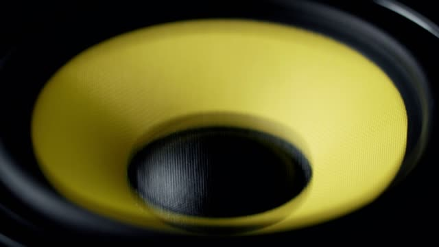 Close up at moving sub-woofer. Speaker part. Black and yellow colors. 4k video video
