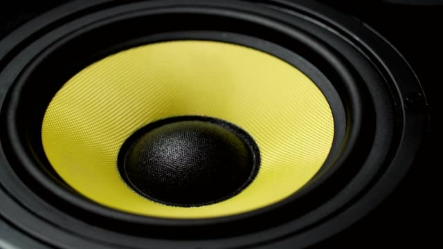 Close up at moving sub-woofer. Speaker part. Black and yellow colors. 4k video Close up at moving sub-woofer. Speaker part. Black and yellow colors of membrane. Concept of musical instrument. 4k video shot. speaker stock videos & royalty-free footage