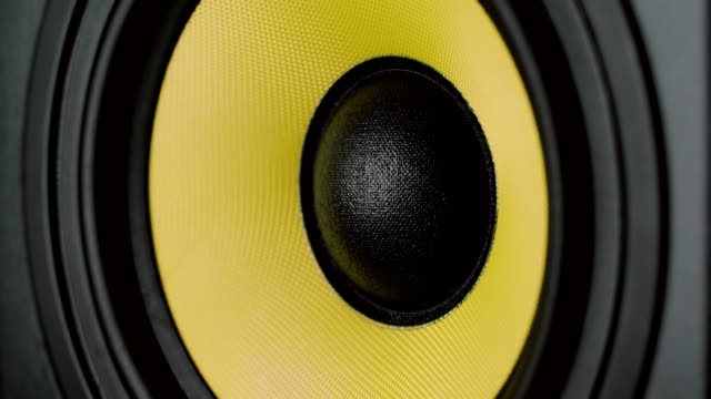 Close up at moving sub-woofer. Speaker part. Black and yellow colors. UHD video video