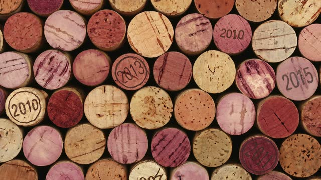 Close up background of used wine corks Background pattern of many assorted stacked used red wine corks, close up, pan slide cork stopper stock videos & royalty-free footage