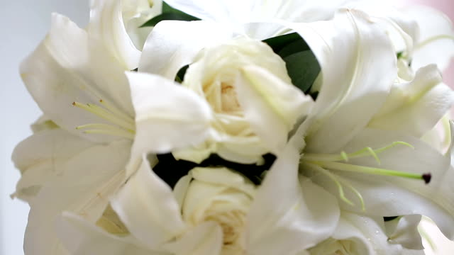 Close up bouquet of blossoming rose in vase. video