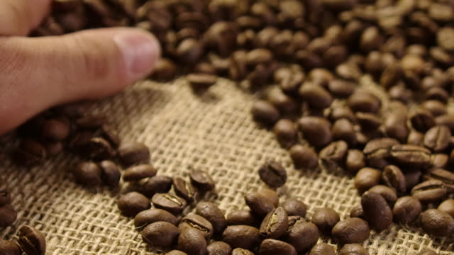 Close up caressing coffe beans 4K slow motion video