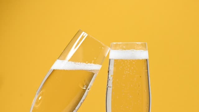 Close up champagne sparkling wine glass on yellow