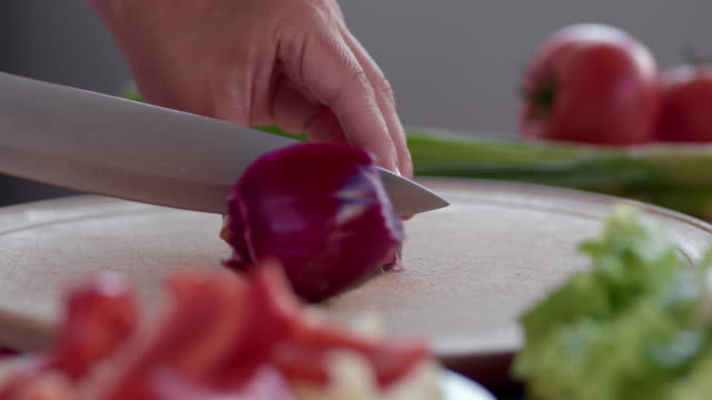 close up chef slicing delicious red onion - alliacee video stock e b–roll