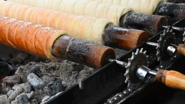 Close up chimney cake baking and rolling video