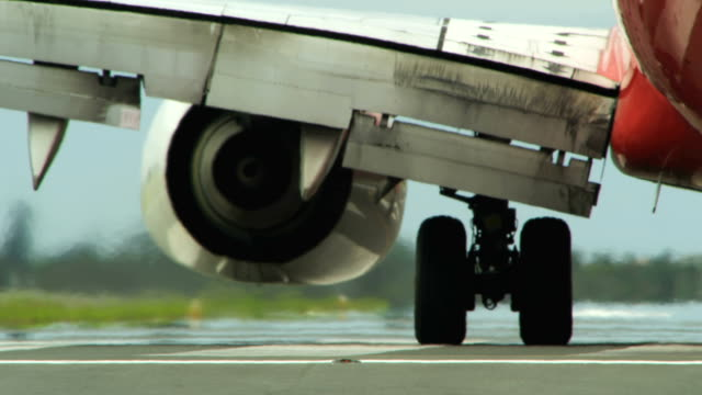 Close up commercial airplane turns at the end of runway video