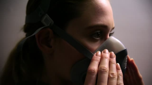 Close Up Coronavirus Scientist/Doctor/Victim Putting On Face Mask Respirator and Safety Goggles. Close Up Coronavirus Scientist/Doctor/Victim Putting On Face Mask Respirator and Safety Goggles. lab coat stock videos & royalty-free footage