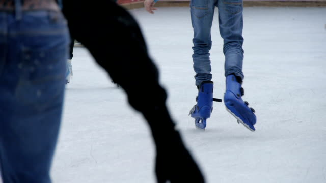 Close up, detail shot of skaters legs and blades in motion. Outdoor skating park video