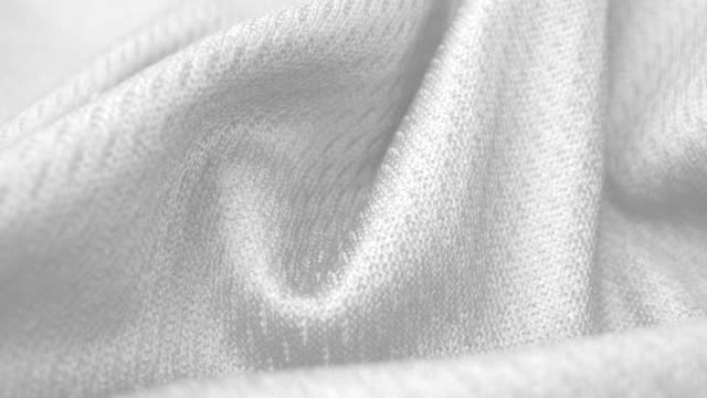 Close up detailed cloth texture of shiny spandex cloth with dolly shot.