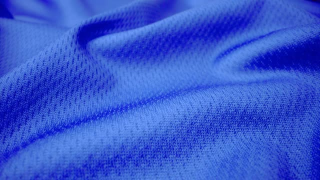 Close up detailed cloth texture of shiny spandex cloth with dolly shot. Close up detailed cloth texture of shiny spandex lycra cloth flowing with dolly shot in macro close-up view. Wavy clean elastic weave material. Textile abstract background. Clothing industry concept. fabric swatch stock videos & royalty-free footage