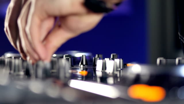 Close up. DJ in Night Club Mixing Tracks at a disco party. video