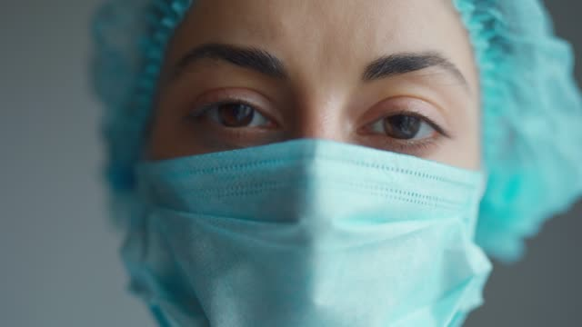 Close Up Doctor or nurse With Face Mask Preparing Surgery Intervention