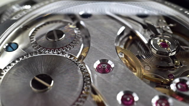 Close up dolly shot of precise watch movement video