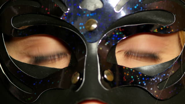 Close up eyes of woman in mask. сlose up video