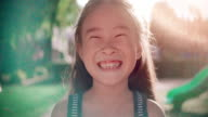 istock SLO MO Close up face of smile happy asian girl 1173510123