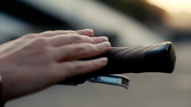Close up Female hand touching handlebar bike slow motion Female hand touching handlebar bike slow motion. Close up woman hand holding a handlebar bicycle handlebar stock videos & royalty-free footage