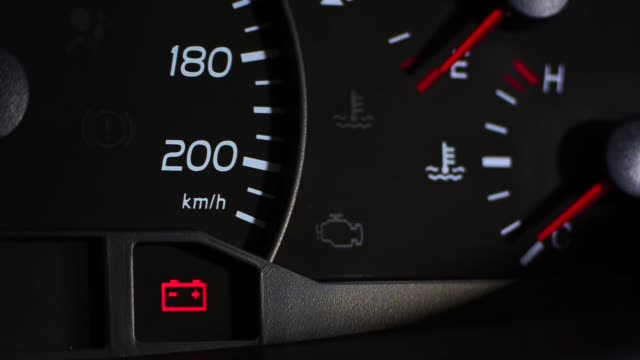 Close up footage of a car's dashboard, with the battery warning light coming on. Close up footage of a car's dashboard, with the battery warning light coming on. dashboard vehicle part stock videos & royalty-free footage