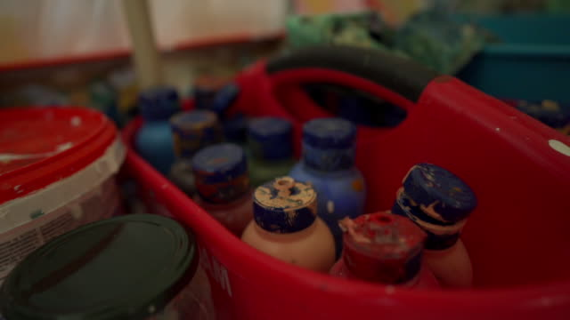 Close up footage of a painting and household equipment in slow motion