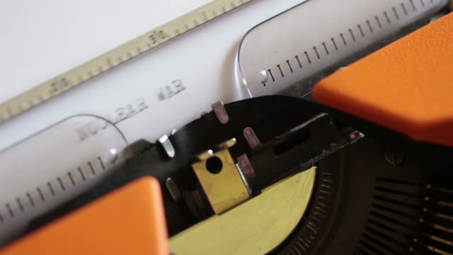 Close up footage of an old typewriter and a person writing NUCLEAR WAR on it... Close up footage of an old typewriter and a person writing NUCLEAR WAR on it... nuclear missile stock videos & royalty-free footage