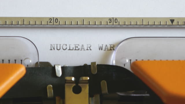 Close up footage of an old typewriter and a person writing NUCLEAR WAR on it Close up footage of an old typewriter and a person writing NUCLEAR WAR on it... nuclear missile stock videos & royalty-free footage