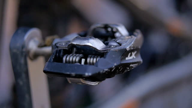 Close up footage of an spinning bicycle pedal video