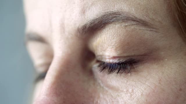 Close up footage of woman's face Close up footage of woman's face and blinking eye. image focus technique stock videos & royalty-free footage