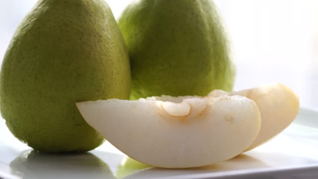 Close up fresh pear slices rotating : 4k Close up fresh pear slices rotating : 4k pear stock videos & royalty-free footage