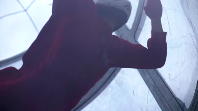 Close up girl skydiver flies in air into wind tunnel. Flying in a wind tunnel video