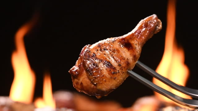 Close up grill roast bbq chicken leg on the flaming grill Close up grill roast bbq chicken leg on the flaming grill . HD slow motion . grilling stock videos & royalty-free footage