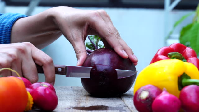 Close up hand chef cutting beetroot