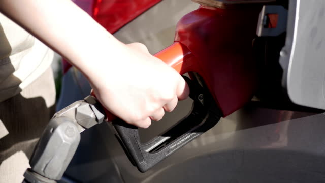 Close up hand filling gas up Close up hand filling gas up handle stock videos & royalty-free footage