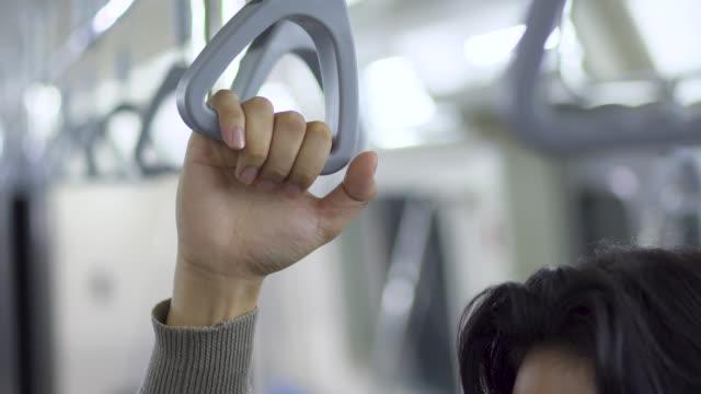 close up hand handrail in train